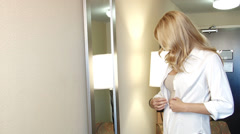 Getting dressed for work beautiful blond business woman - stock footage