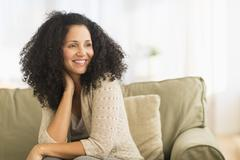 Stock Photo of Portrait of mid adult woman sitting on sofa