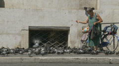The Pigeon lady 1 (slomo dolly) Stock Footage