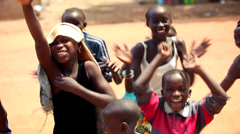 GAMBIA, 08 MARCH 2012: Group of young African children sing traditional song. Stock Footage