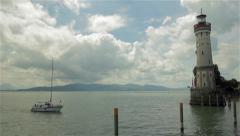 Lighthouse at entrance to marina of Lindau Stock Footage