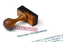 Income assignment - approved Stock Photos