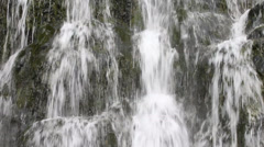 waterfall vertical water flows from the rock - stock footage