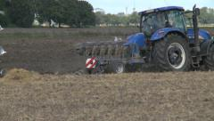 Farmer plowing field - HD Stock Footage
