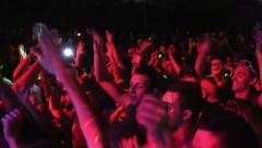 dancing people: concert crowd in front of the stage moving hands and arms - stock footage