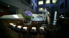 Decoration with candles, champagne and glasses in front of jacuzzi while young Stock Footage