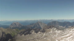 Pan from mountainrange to summit of Zugspitze Stock Footage