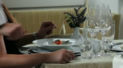 Beautiful and unique place setting for romantic dinner and waiter who brings Stock Footage