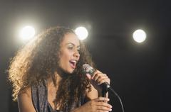 Stage performance of young singer - stock photo