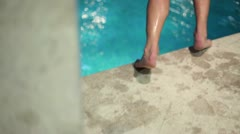 Man who jumps in to the pool Stock Footage