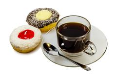 Two pieces of donuts and a cup of coffee - stock photo