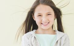 Stock Photo of Girl (8-9) smiling, portrait