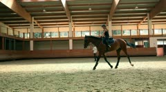Big hall for training young girl riding horse for equestrianism Stock Footage