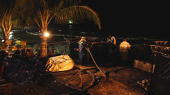 OIL SPILL DISASTER WORKERS NIGHTTIME CLEAN UP Stock Footage