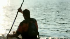 Young people slowly canoeing in the lake Stock Footage