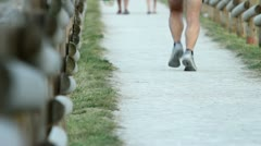 People recreatively jogging in the nature Stock Footage