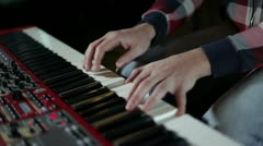Musican playing keyboards Stock Footage