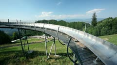 Bobsled track up the hill with perfect view Stock Footage