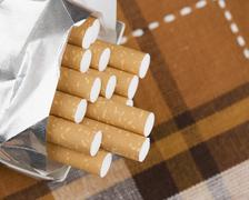 Closeup of a pack of cigarettes - stock photo