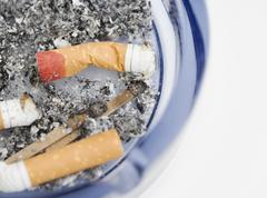 Still life of cigarettes in ashtray - stock photo