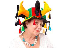 Senior lady with jester's hat Stock Photos