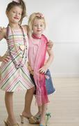 Two young sisters playing dress-up Stock Photos