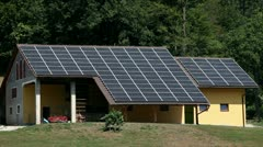 Close up of solar panel houses on a farm Stock Footage