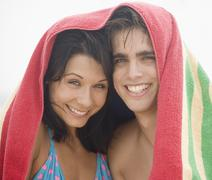 Couple smiling with towel over their heads Stock Photos