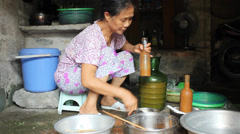 Rural woman make sauce from rice Stock Footage