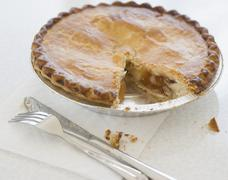 Close up of pie with piece cut out - stock photo