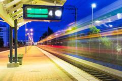 Night railway station - stock photo