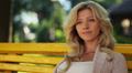 Pretty blond female tender smile and laugh sitting, park bench HD Footage