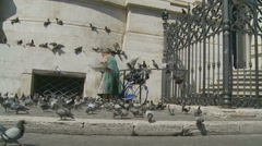 The Pigeon lady 8 (slomo dolly) Stock Footage