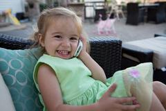 Cute little girl on the phone Stock Photos