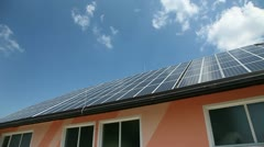 Solar panels on a roof with clouds in the back Stock Footage