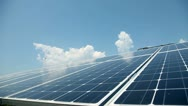 Stock Video Footage of solar panels with clouds in the back