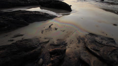 OIL SPILL DISASTER BEACH SAND REFRACTION WATER Stock Footage