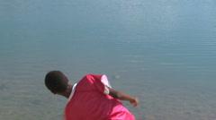 Boy skips rock. Stock Footage