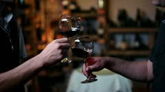 Two people toasting with red wine - stock footage