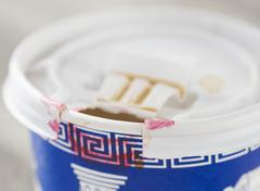 Stock Photo of Close up of take out coffee