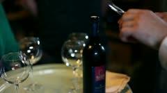 Waiter is opening a bottle of fine wine Stock Footage