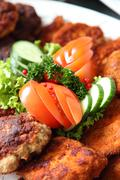 Crumbed fried meat and fish on a buffet Stock Photos
