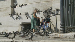The Pigeon lady 7 (slomo dolly) Stock Footage