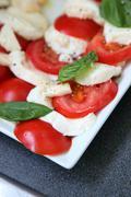 Tomatoes and mozzarella Stock Photos