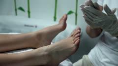 Feet massage in beauty spa salon Stock Footage