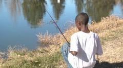Boy fishing. - stock footage