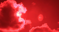 Sun disk from cumulus on red sky Stock Footage