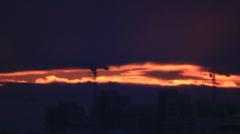 Light gape in dark night clouds over town in the dark Stock Footage
