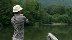 Young man fishing in a beautiful nature Stock Footage
