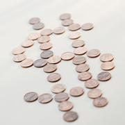 Dollar sign made of pennies - stock photo